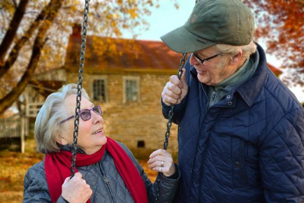 Elderly people on swing