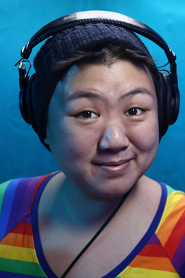 A headshot of Cherie Tay, an AAPI voiceover artist